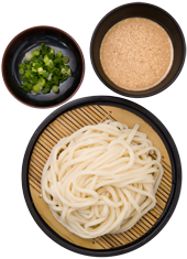 Goma Zaru Udon: Chilled fresh udon noodles served on a zaru mat with our signature sesame dipping sauce and sliced green onions on the side. Have it with or without chili oil.